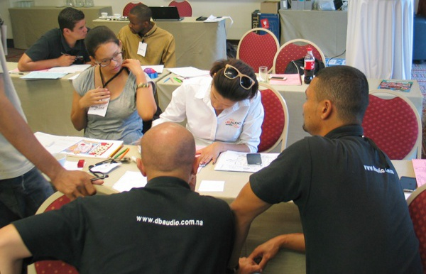 Team members from a top Namibian audiovisual company engage in a planning exercise during a Project Management short course.