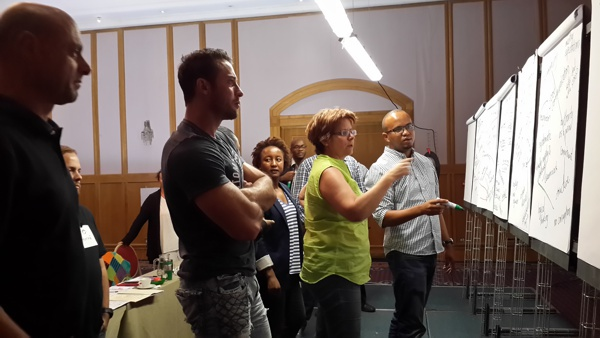 Participants in a Windhoek course examine the interdependence of systemic factors in a project.