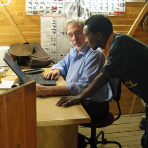 Manager and team member in site office